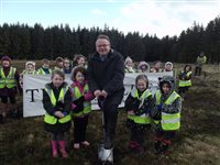 Children plant trees at Conrhenny - picture